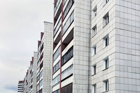 many windows: house with many windows on sky background