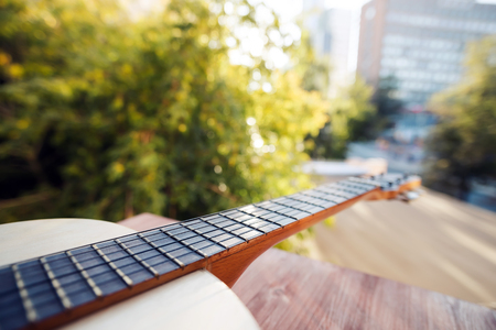 ballad: Guitar against the background of the cityscape