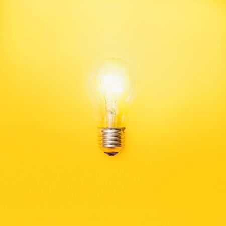 light bulb on yellow background. symbol ideas