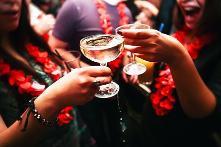 sparkling wine: Clinking glasses with alcohol and toasting, party. Congratulations to the event. Cheerful party friends Stock Photo