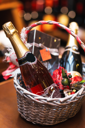 sparkling wine: Bottle of wine in basket. Gift for holiday