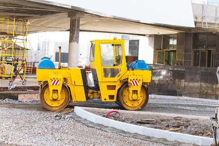 wheel loader: wheel loader excavator working with crushed stone Stock Photo