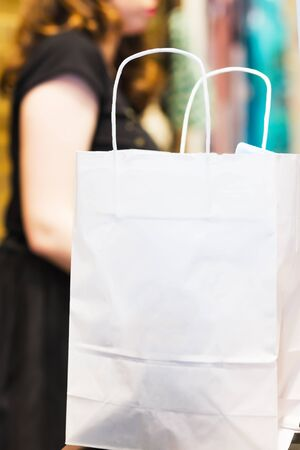 saleslady: Shopping bags standing at the checkout. An empty package. Background for the image