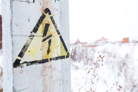 high voltage sign: Danger Electrical Hazard High Voltage Sign. Winter nature on background