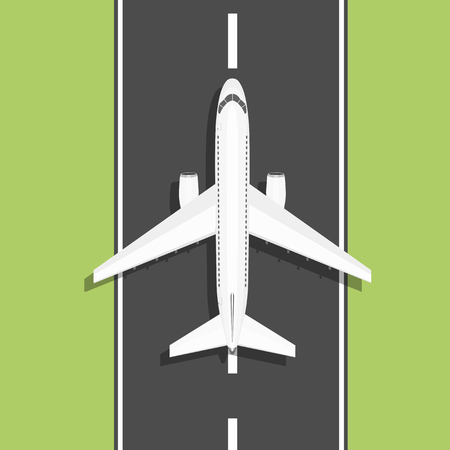 runway: Aircraft is on the ground. View from above. White airplane rides on the runway