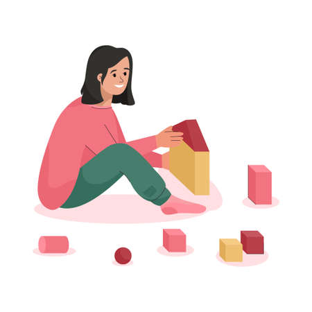 Happy girl plays with toy cubes and sitting on floor scene
