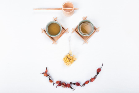 Green tea in a good mood on a white background. Stock Photo