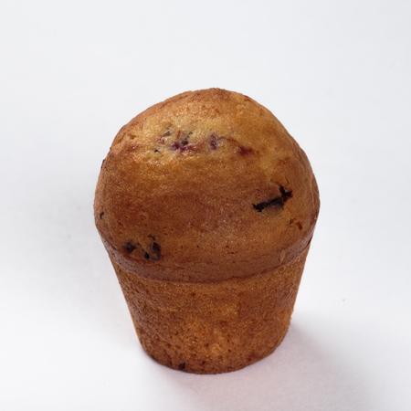 Cupcake with raisins homework on white background.