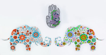 A set of sketches of hamsa and elephants in flowers on a white background. Stock Photo