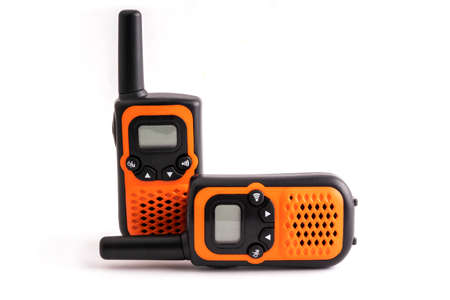 Stay in touch - two walkie-talkies in orange and black colors on white background. High quality photo 免版税图像