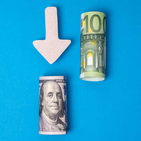 Comparison of dollar and euro exchange rates. Paper currency on blue background 免版税图像