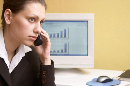 phonecall: Woman in an office Stock Photo