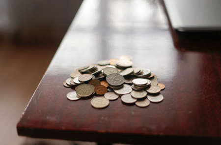 A handful of coins on the table