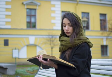 women friendship: The girl in the street, reading a book.