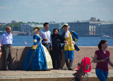 performers: Russia Saint Petersburg July 2016 street performers pose with tourists