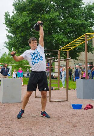 wins: a young man wins the competition for raising weights