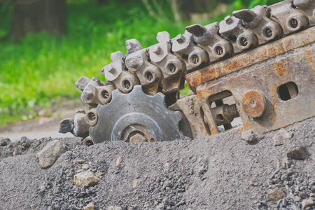 macadam: is the repair of the road where the tractor a chain saw cut the road surface Stock Photo