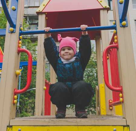 5 years old: child 4, 5 years old playing in the Playground.