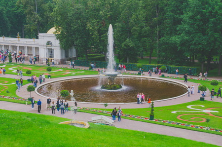 SAINT PETERSBURG, RUSSIA - June , 2016: tourists at Peterhof Palace. Peterhof Palace included in the world heritage List of UNESCO.