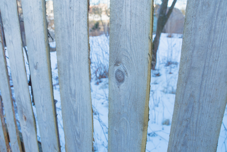 old wooden fence in the countryside. Stock Photo