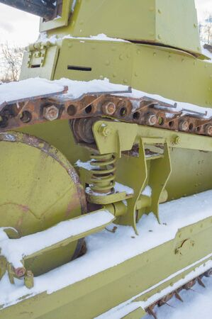 weaponry: the tank tracks and the tracks under the snow.