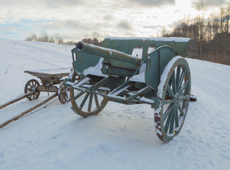 winter in the field is a cannon of the second world war. Stock Photo
