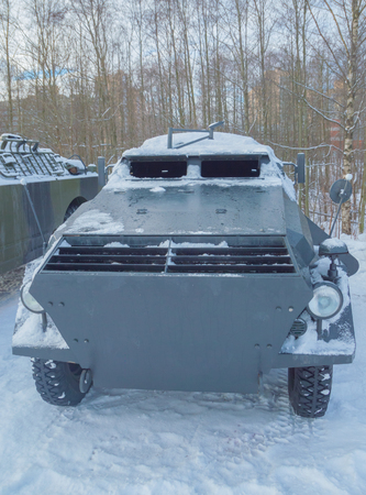 in the winter on a snowy road, a German armored car.