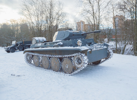 on a snowy road moving German tank of the second world war.