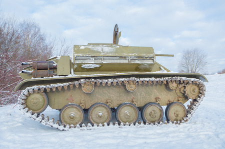 tank t-70 with an unfolded cover of the engine compartment.