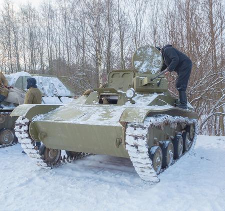 near the Russian t-60 crew prepared the car for departure. Stock Photo