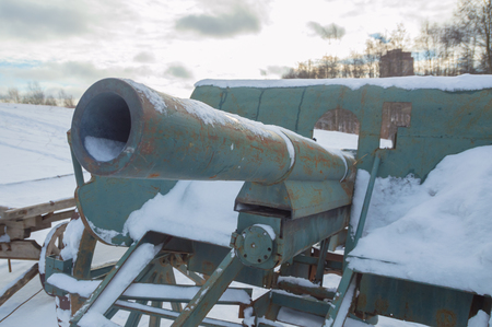 gun of the second world war stands in the snow.