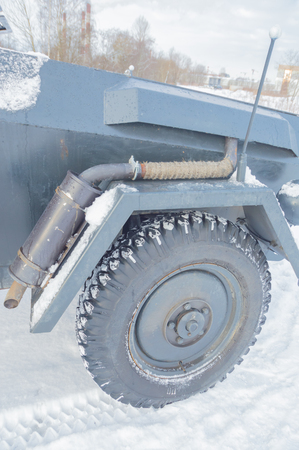 German armored vehicle, front wheel and exhaust pipe.