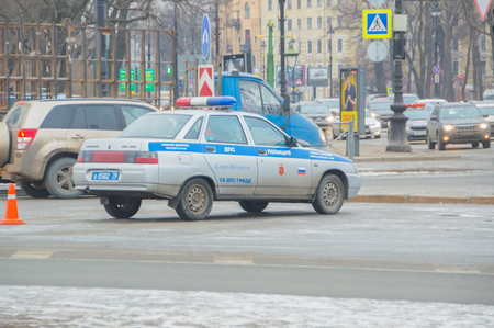 Russia, Saint-Petersburg, February 16, 2017 - car traffic police looking for violators at the intersection. Редакционное
