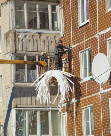 Russia, Saint-Petersburg, Nikolsky 14 Feb 2017 - working hammer working on the facade of the house. Editorial