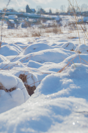 winter grass covered with snow on a bright day. Stock Photo
