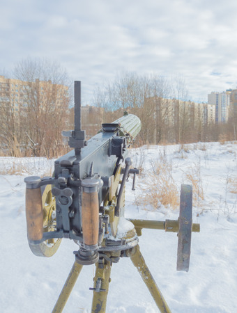 tripod mounted: winter on tripod stands and a Maxim gun, close up. Stock Photo