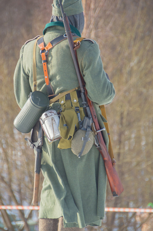 in winter, German soldiers with ammunition, from behind.