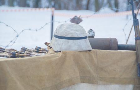 close-up,  helmet and a belt-fed weapon world war II. Stock Photo