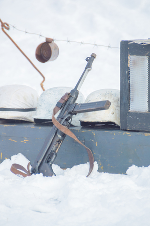 german handgun: winter on the box are German helmets and machine during the second world war. Stock Photo