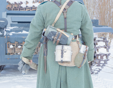 in the winter the German soldiers going to the tank.