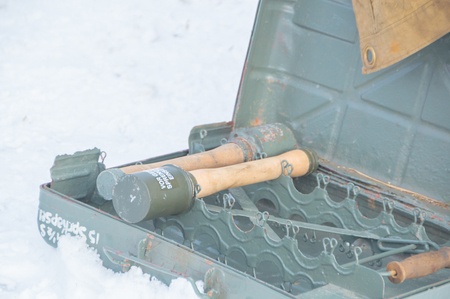 a German grenade during the second world war in a box in the snow. Stock Photo