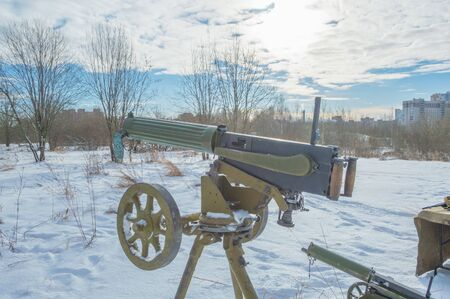 tripod mounted: closeup, Maxine machine gun on a tripod in the snow. Stock Photo