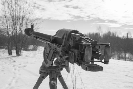in the winter on the tripod Russian heavy machine gun, black and white.