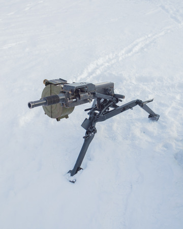 the snow is a Russian heavy grenade launcher. Stock Photo