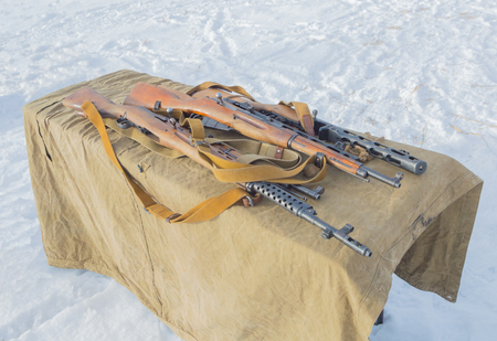 winter on the table samples of Russian weapons during the second world war.