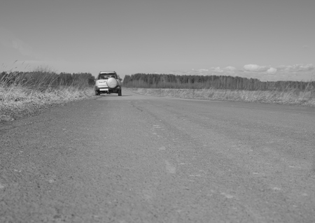 black and white, off-road car on a deserted road. 版權商用圖片