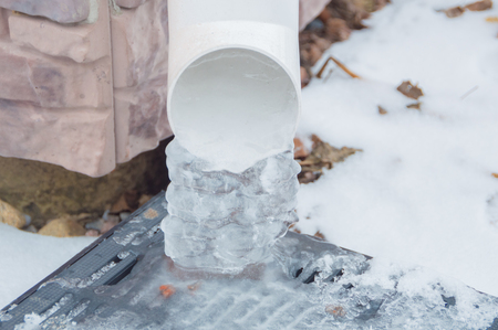 the ice sounded the trumpet of the storm drains in the winter. Stock Photo