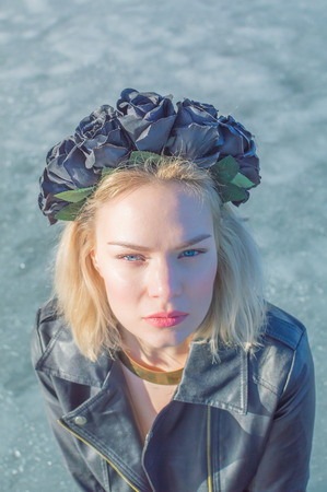 quite: closeup of beautiful girl with a black wreath on his head.