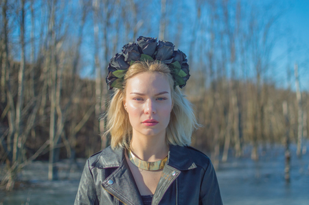 portrait of girl with wreath of black flowers on his head. Imagens
