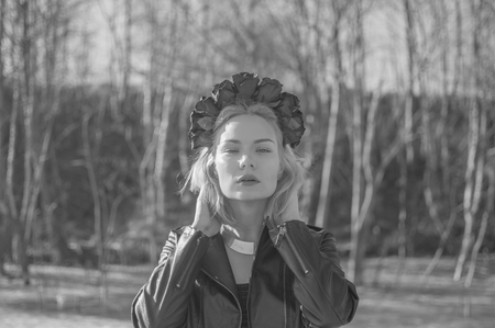 black and white, straightens hair girl with a wreath of black flowers. Imagens
